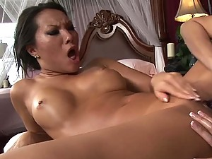The nasty Asian masseuse gets dildo fucked by her client