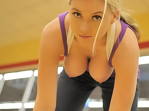 Alison Angel - This gym is full of people but even in spite of that, adventurous blonde honey Alison won't miss the chance to flash her amazing big boobs there.