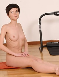 Explicit yoga stretching by a naked sport girl
