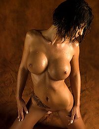 The girl with the big perfect tits is wet and shiny and she looks so good