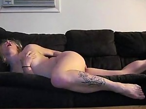 Blonde Girl Masturbates on the Couch