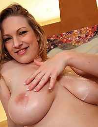 Naturally Busty Blonde Doused In Cum