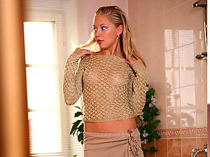 Sandy Fair - In her hot video Sandy Fair is wearing a sheer sweater and a skirt and if you like your ladies in something soft and sexy she's the one.