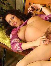 Naughty Pregnant Vixen Exposes Her Muff