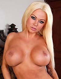 Busty Blonde Nikita Spreads Plump Pussy