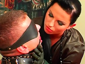 Leather skirt on sexy mistress abuses him