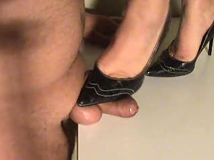 She steps on his cock with heels