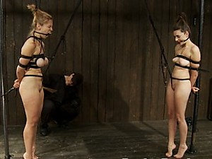 Audrey and Missy are bound with belts, hair tied to the other girl's pussy. They are caned and made to tug on each other to earn breathtaking orgasms.