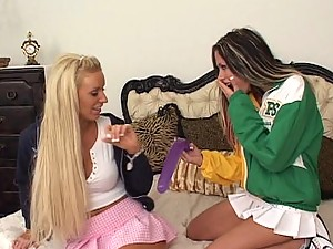 Long haired blonde cheerleader Eve Lawrence fers slit fingered and toyed by a lesbian
