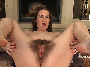 All natural Erin Eden strips off, lays on her back and spreads her thick legs. Her big thick hairy pussy will captivate your attention instantly.