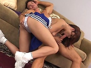 Redheaded cheerleader Autumn Starr sucks and rides a giant cock
