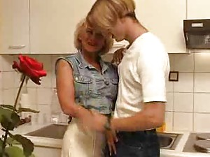 Fucking his busty aunt in the kitchen
