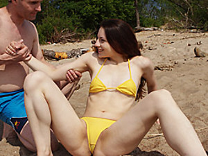 A horny yellow bikini chick fucked on the beach hardcore